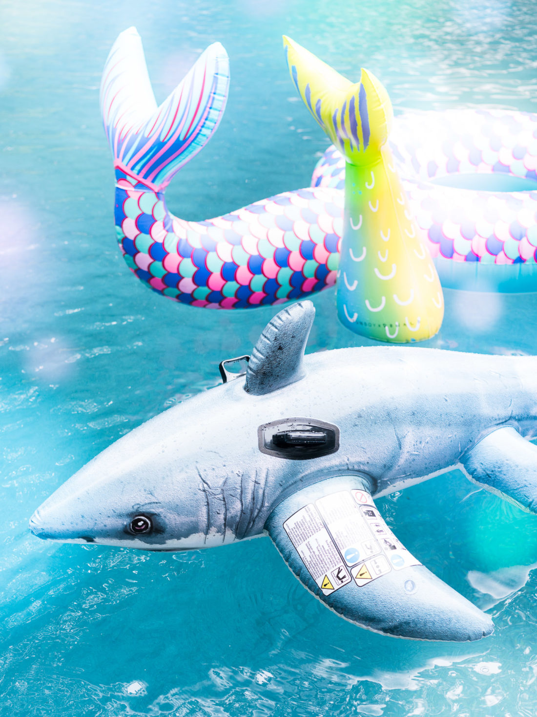 The pool floats at Marlowe Martino's third birthday party with a Mermaids vs. Sharks theme