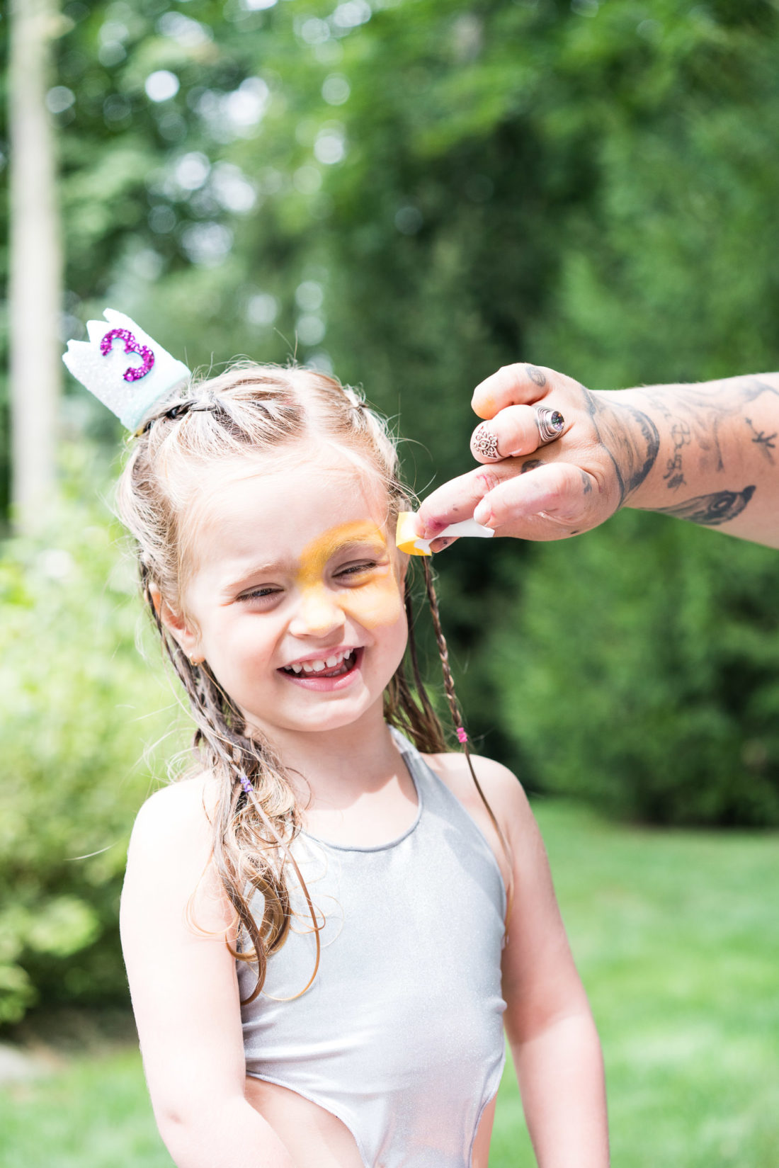 Marlowe Martino gets her face painted for a second time at her third birthday party