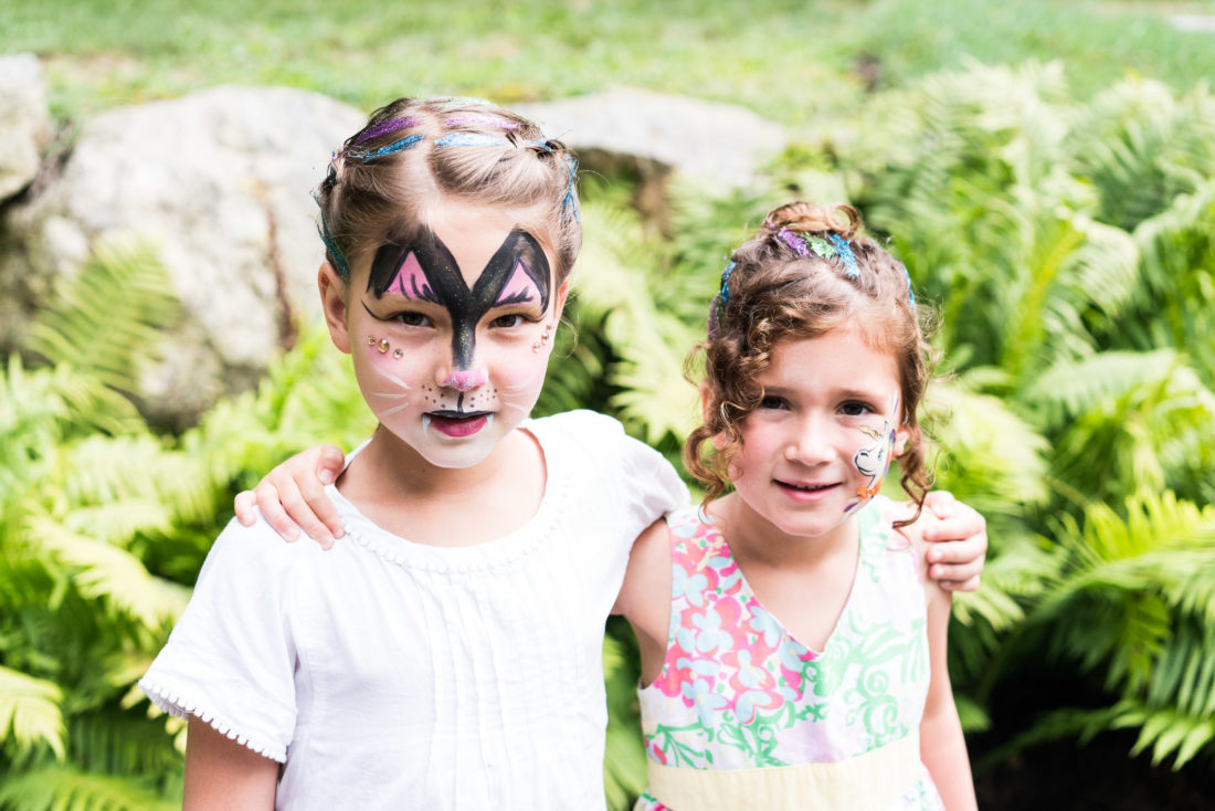 Marlowe Martino gets her face painted like a tiger at her third birthday party