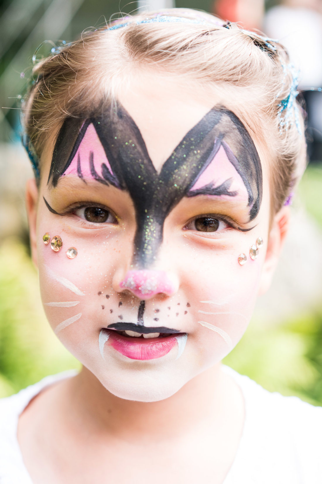 Guests get their face painted at Marlowe Martino's third birthday party