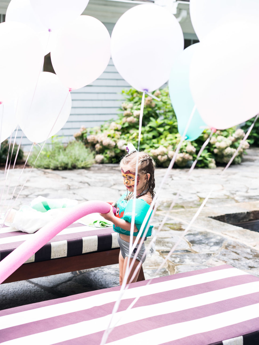 Marlowe Martino plays by the pool at her third birthday party