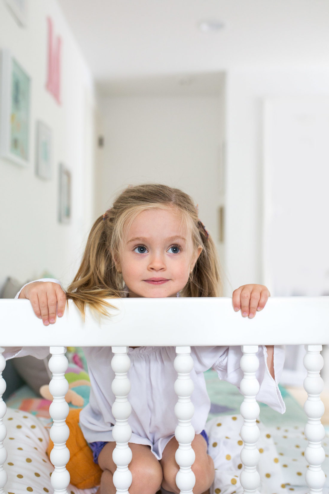 Marlowe Martino peeks over the edge of her Incy Interiors Big Girl bed
