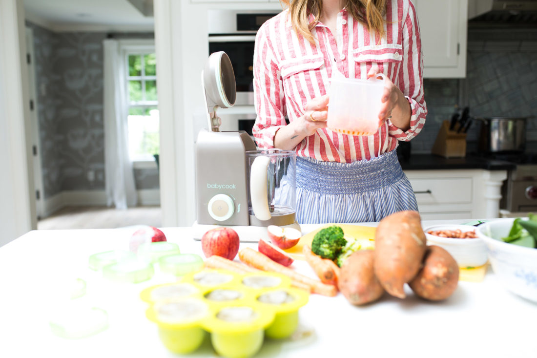Eva Amurri Martino drops chopped carrots in to the steamer of her beaba babycook pro baby food maker