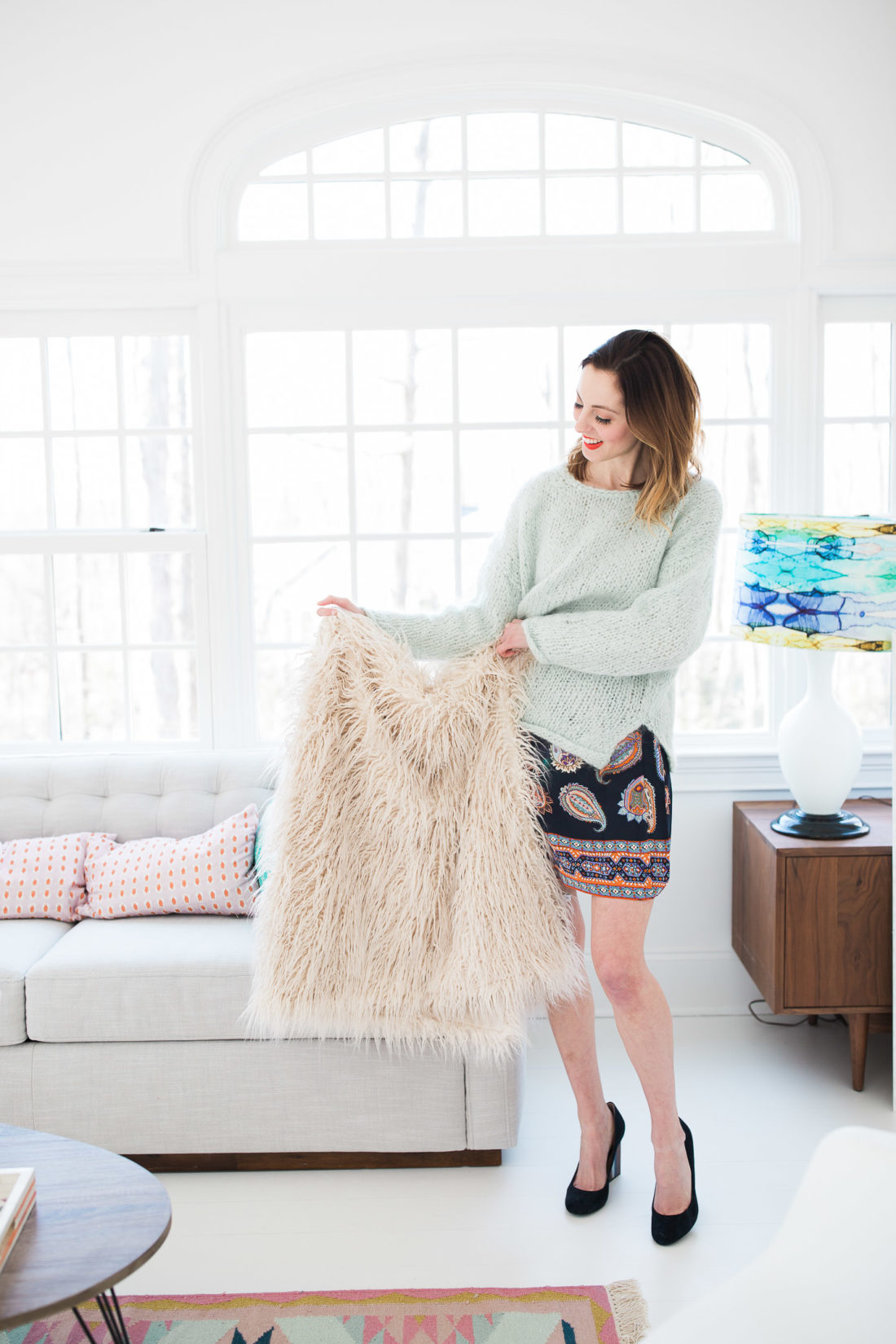 Eva Amurri Martino holds up a fuzzy shag throw blanket in her studio