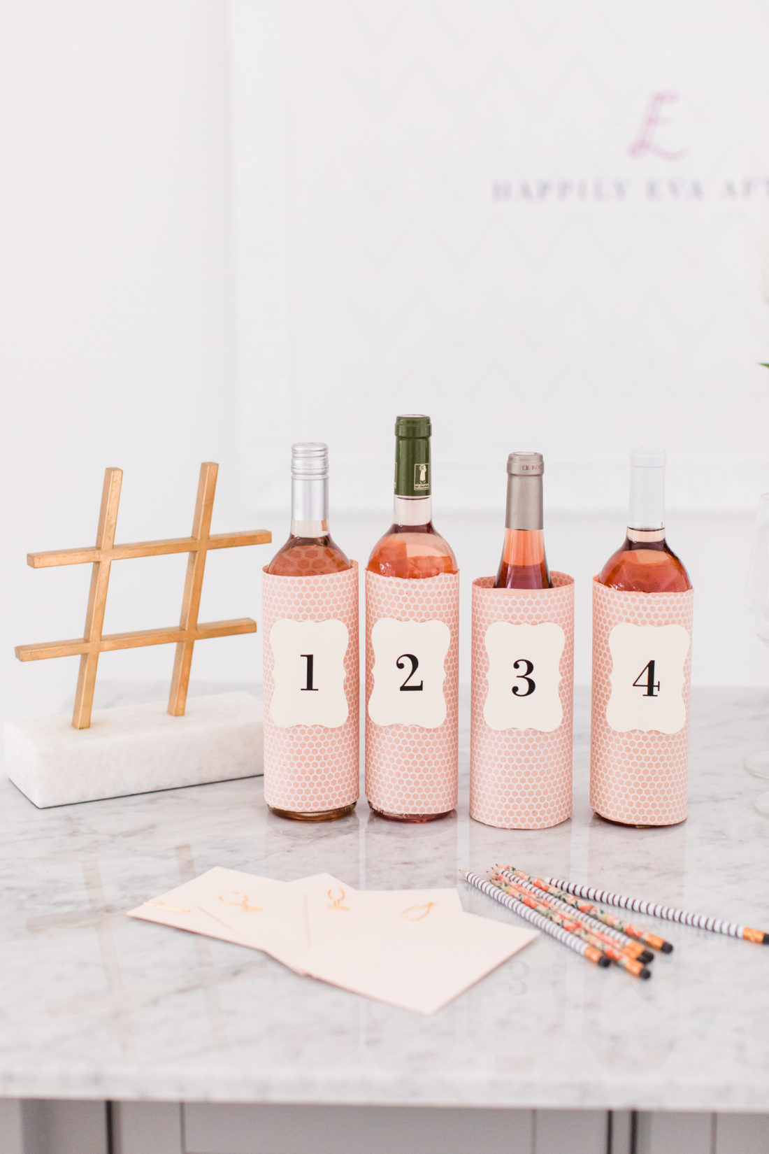 Eva Amurri Martino hosts a Rosé tasting party at her Conecticut home, and wraps varying bottles of Rosé in pretty pink paper