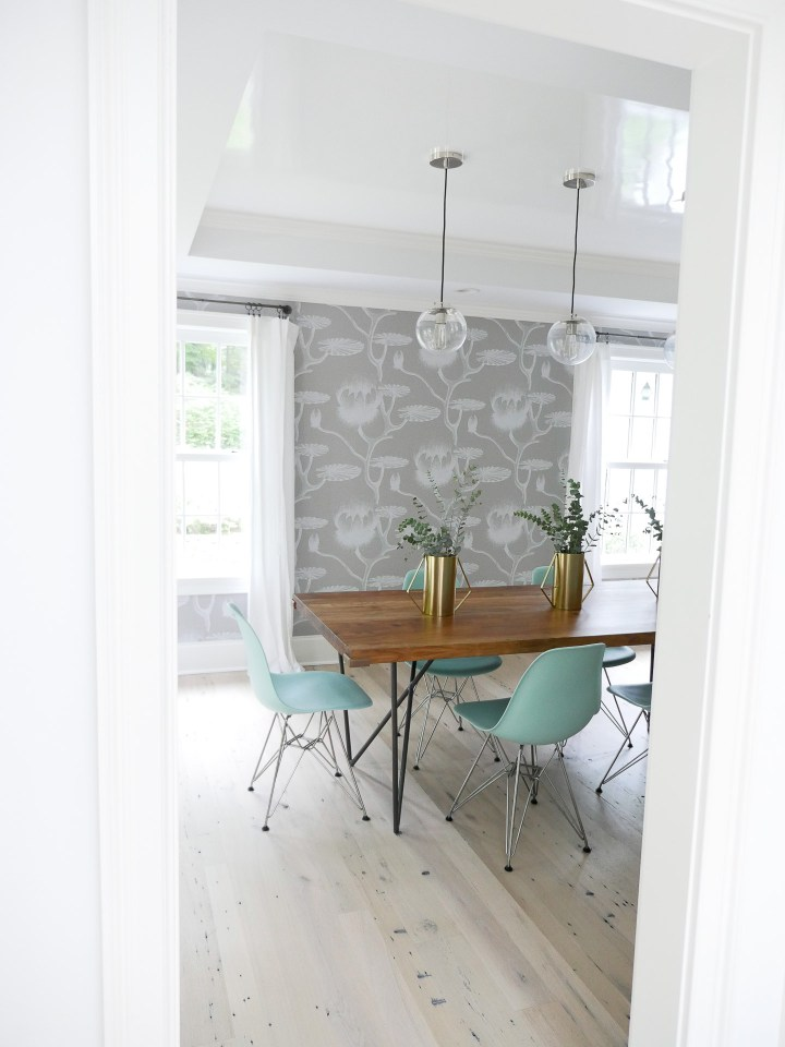 The modern and chic dining room in Eva Amurri Martino's Connecticut home, featuring robins egg blue eames molded plastic eames chairs
