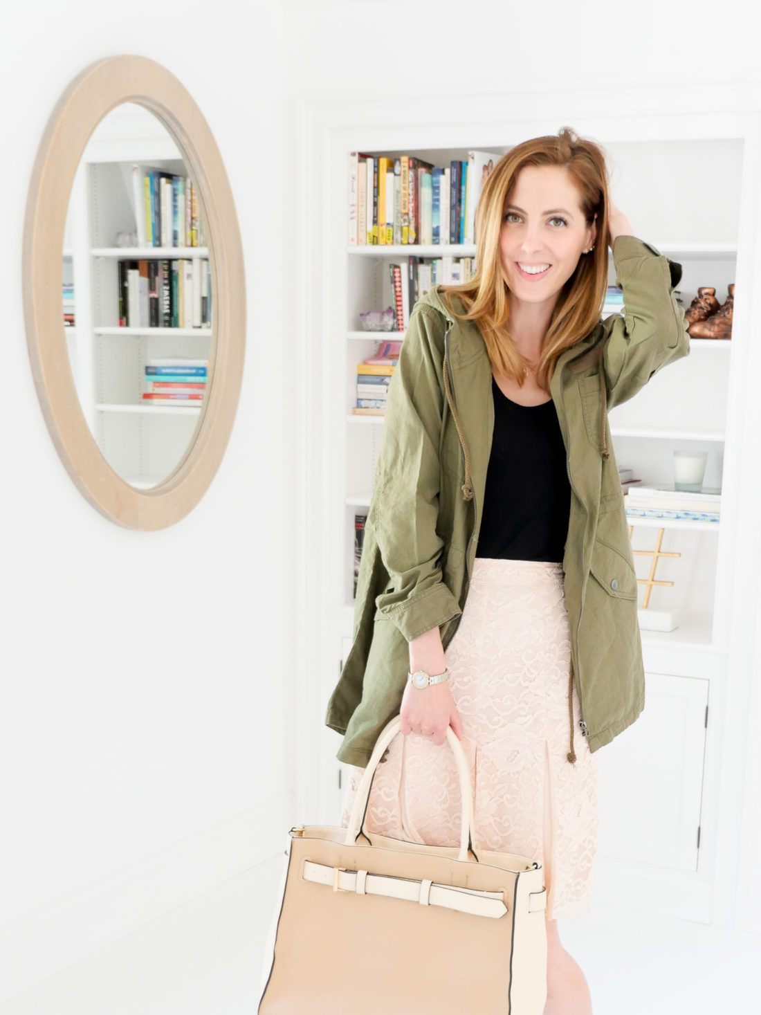 Eva Amurri Martino wears a pink lace skirt, and an olive anorak jacket in the Happily Eva After studio in Connecticut