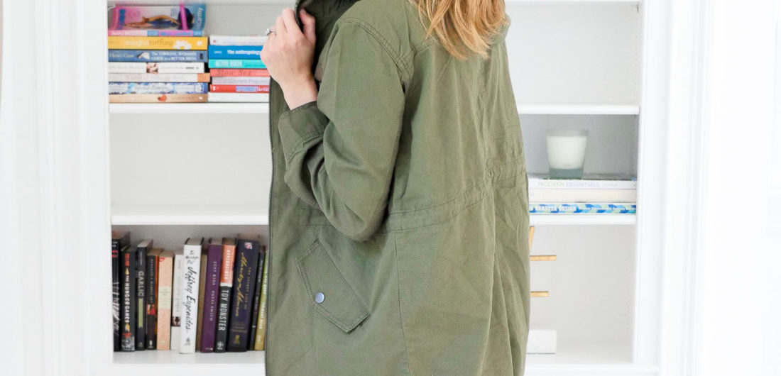 Eva Amurri Martino wears an olive green hooded anorak jacket over a black tank top