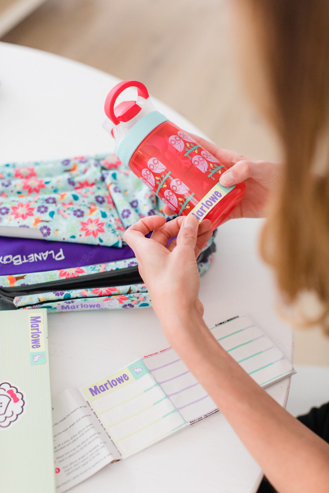 Eva Amurri Martino labels a water bottle to prepare daughter Marlowe for school