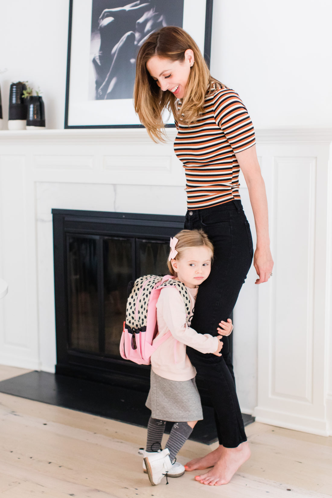 Marlowe Martino hugs her Mom's leg as she gets ready to head off to the first day of Preschool