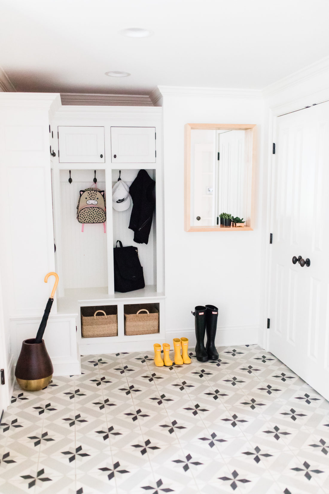 The Black and white mud room in Eva Amurri Martino's Connecticut home featuring black and white patterned cement tile