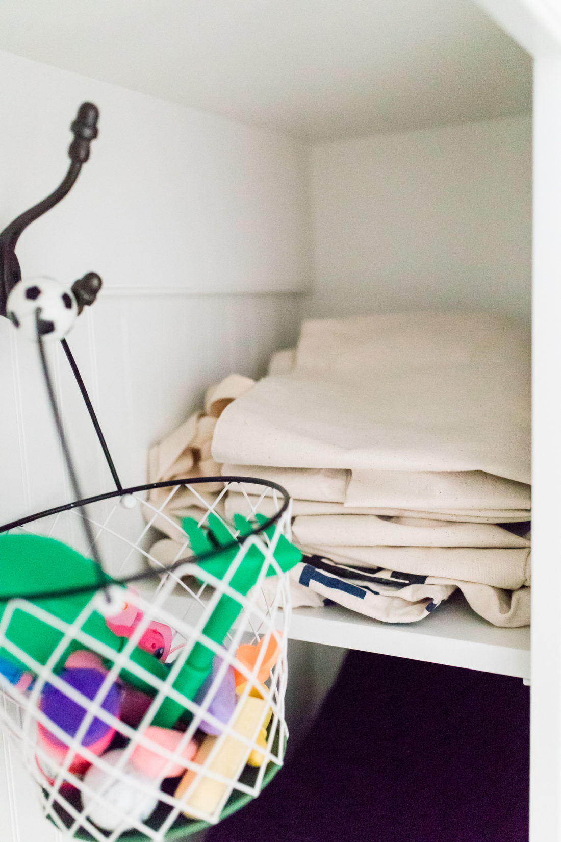 stacked canvas bags in the cubby of Eva Amurri Martino's Connecticut mud room