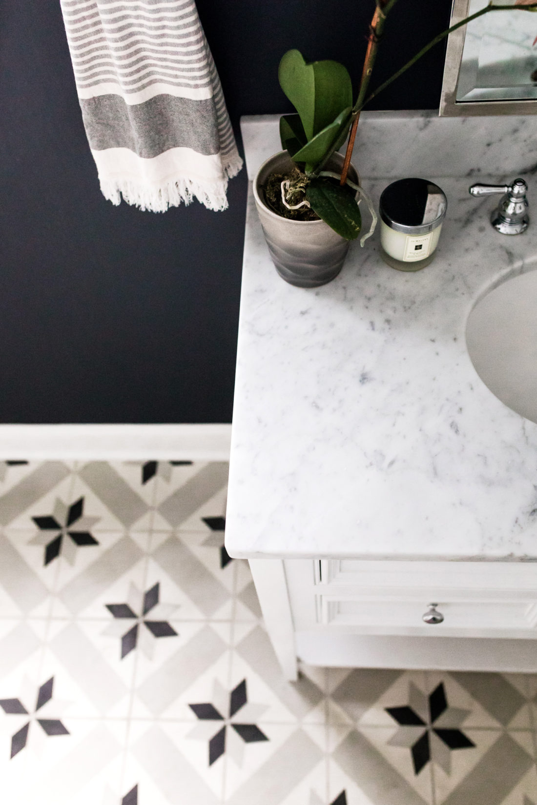 Eva Amurri Martino shares the full redesign of her black, white, and grey concept powder room in her Connecticut home