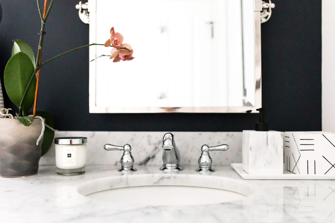 The faucet and marble vanity of Eva Amurri Martino's powder room in her Connecticut home