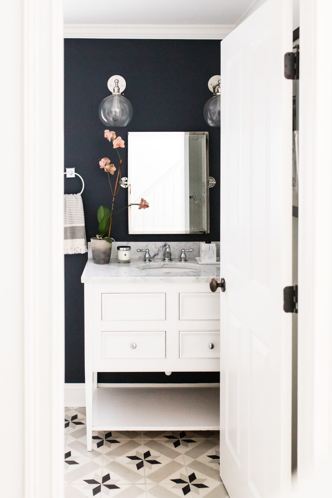 Eva Amurri Martino shares the black, white, and grey design of the powder room in her Connecticut home