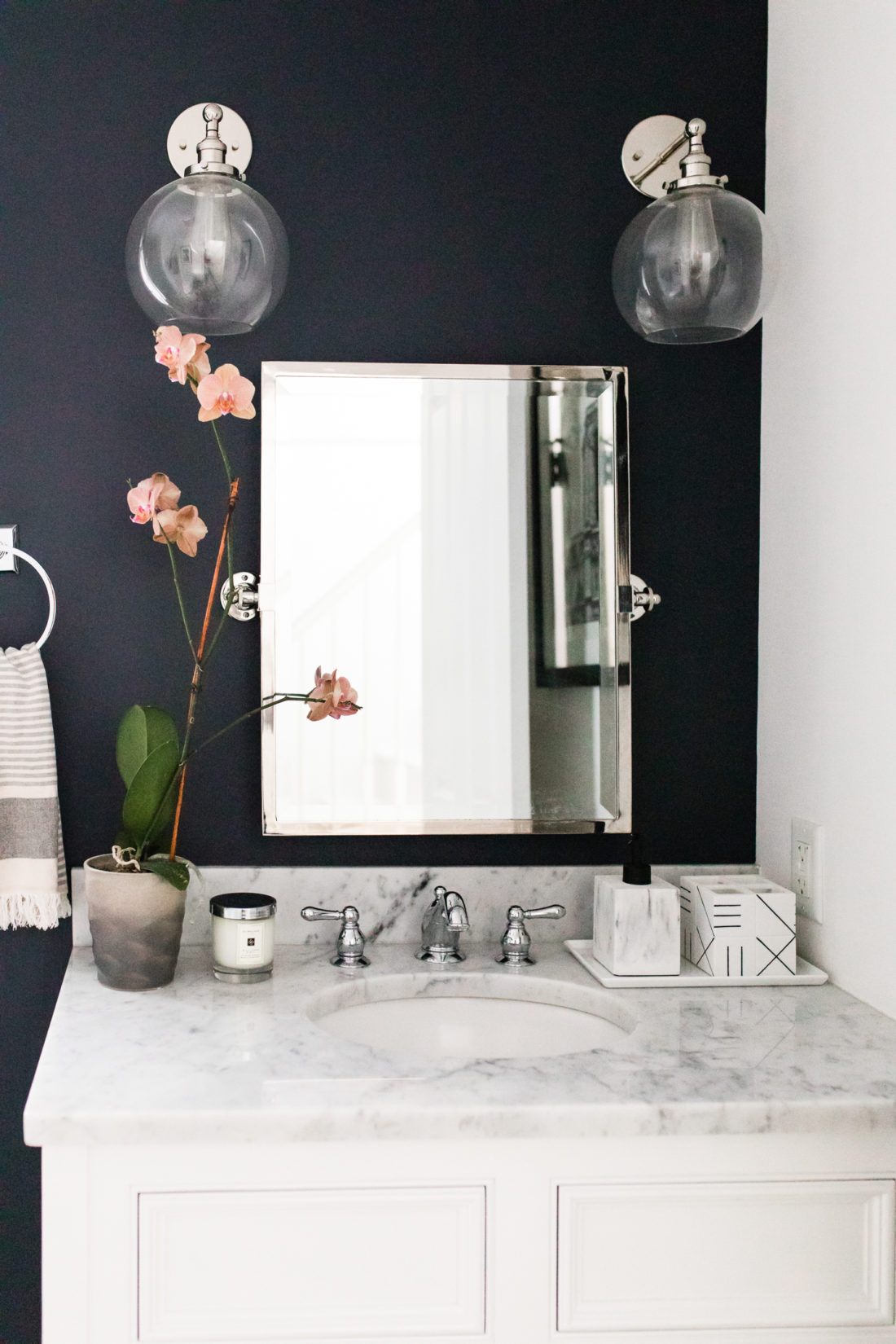 The wall sconces, vintage mirror, and marble vanity of Eva Amurri Martino's Connecticut powder room