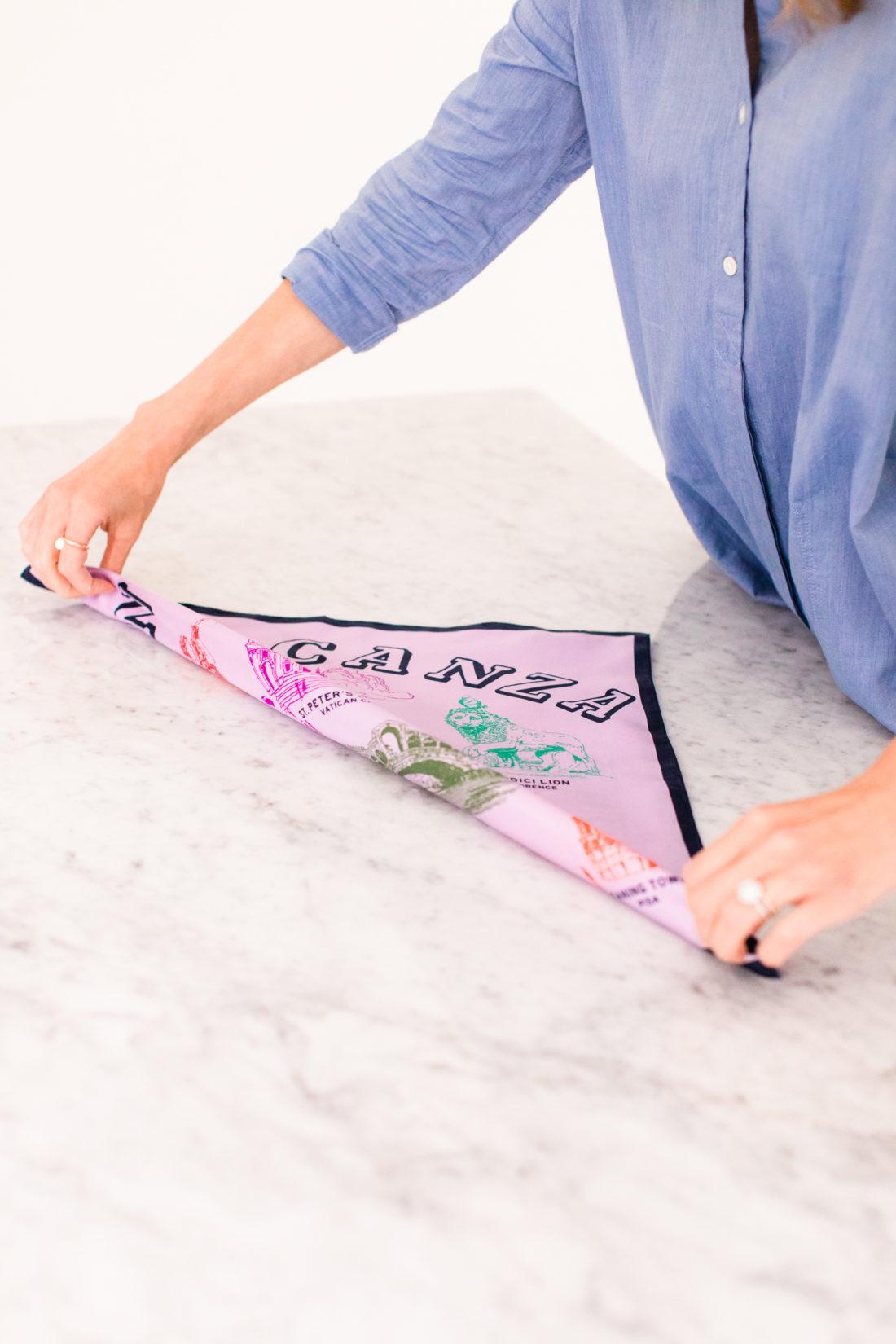 Eva Amurri Martino folds a square silk scarf to tie in to a kerchief choker
