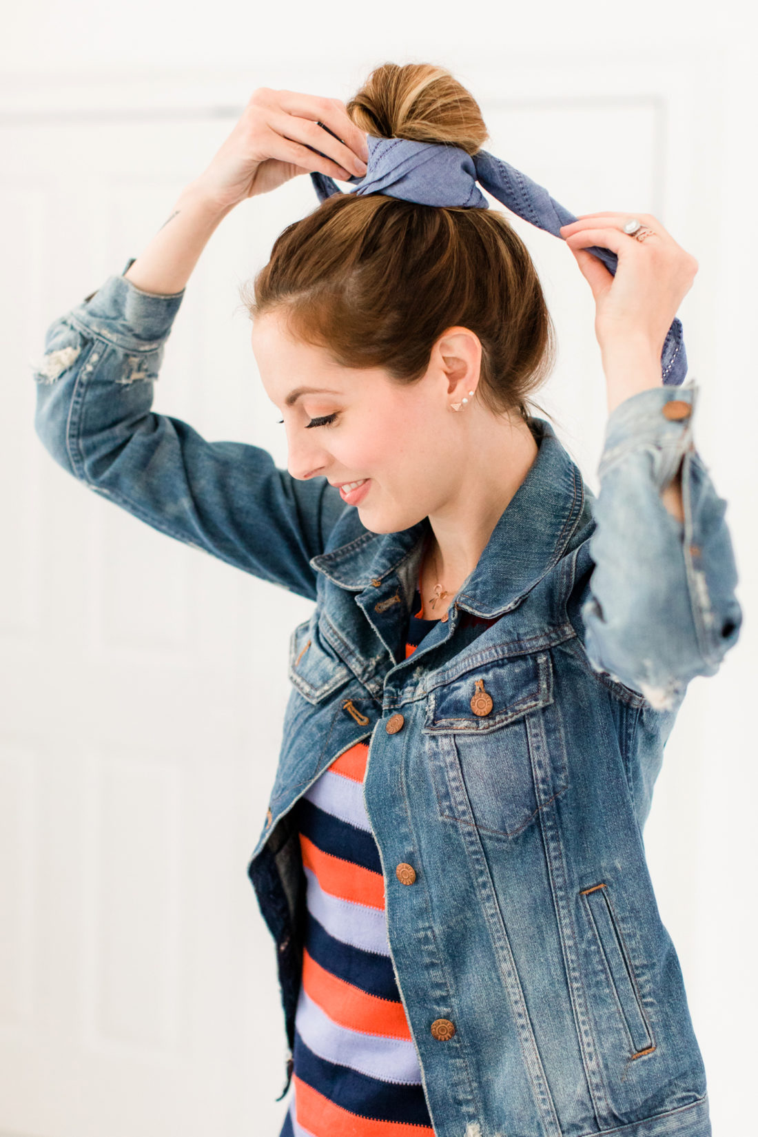 Eva Amurri Martino wears a striped dress and denim jacket, and wraps a linen kerchief around her bun to make a hairstyle
