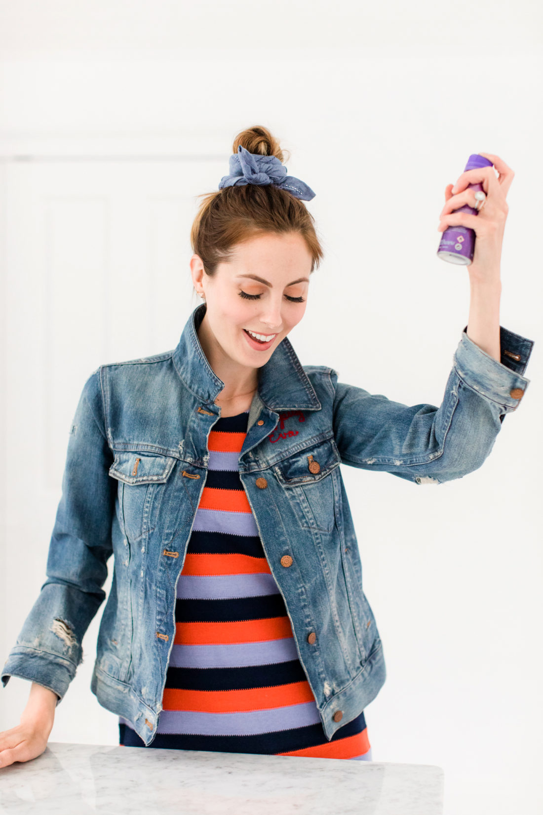 Eva Amurri Martino sprays her kerchief bun hairstyle with felxible hold hairspray