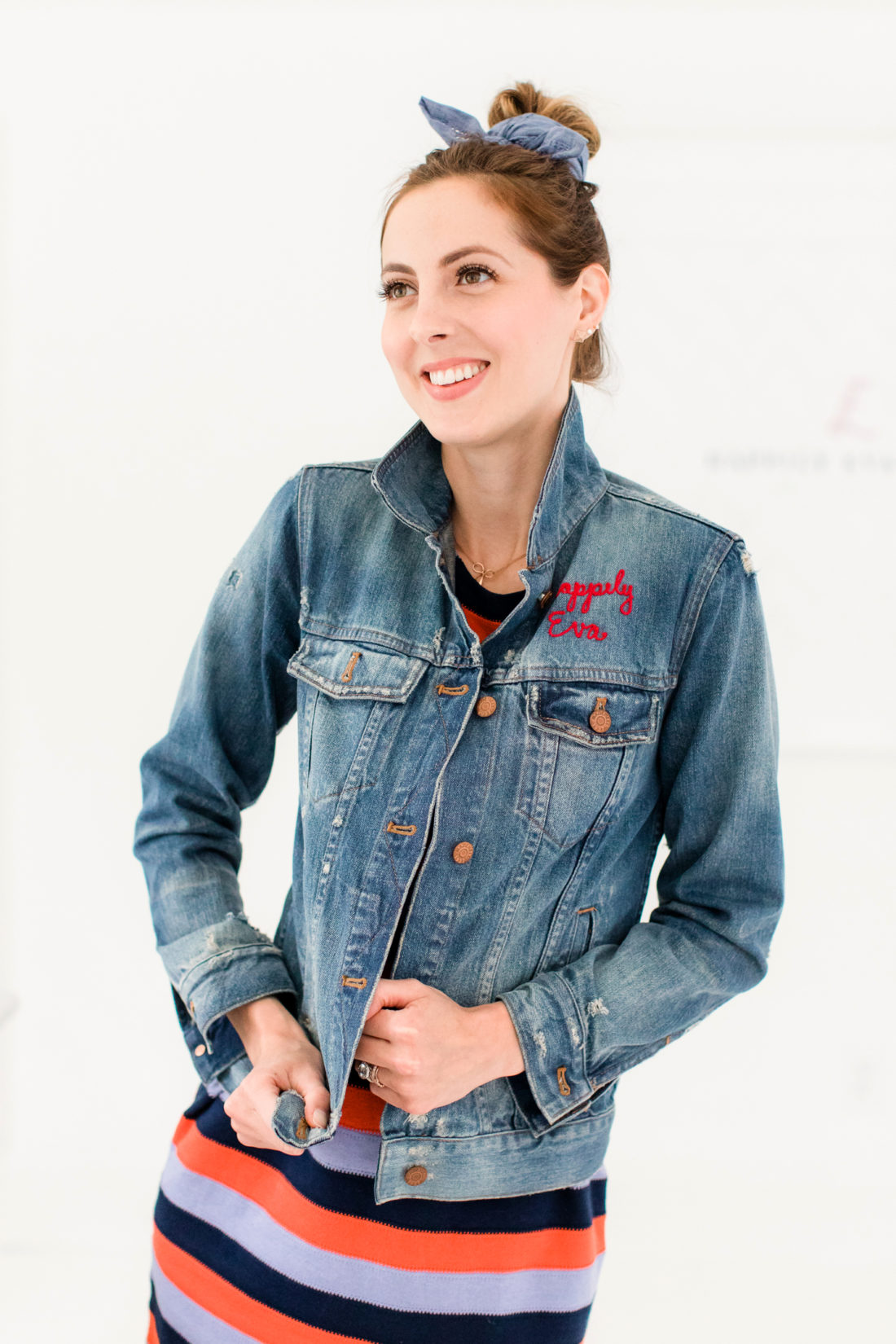 Eva Amurri Martino wears a striped dress and denim jacket and wears a simple kerchief bun in her hair