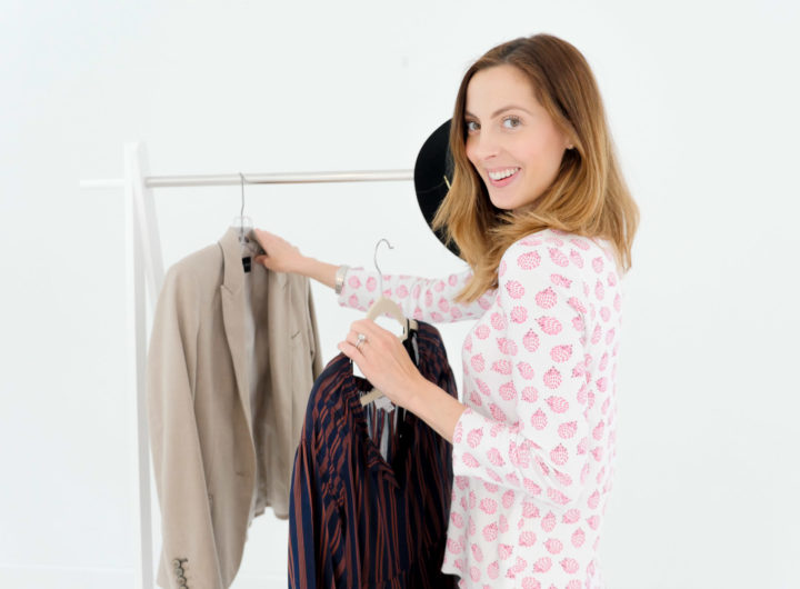 Eva Amurri Martino selects her clothes for the next day and hangs them on a white clothes rack as part of her night time routine
