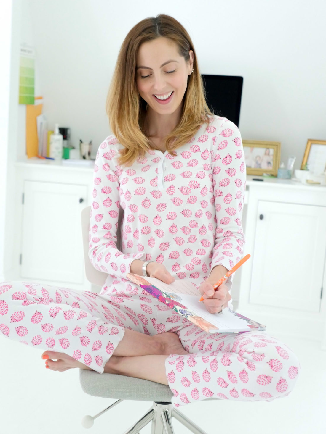 Eva Amurri Martino sets her calendar for the day ahead, wearing pajamas