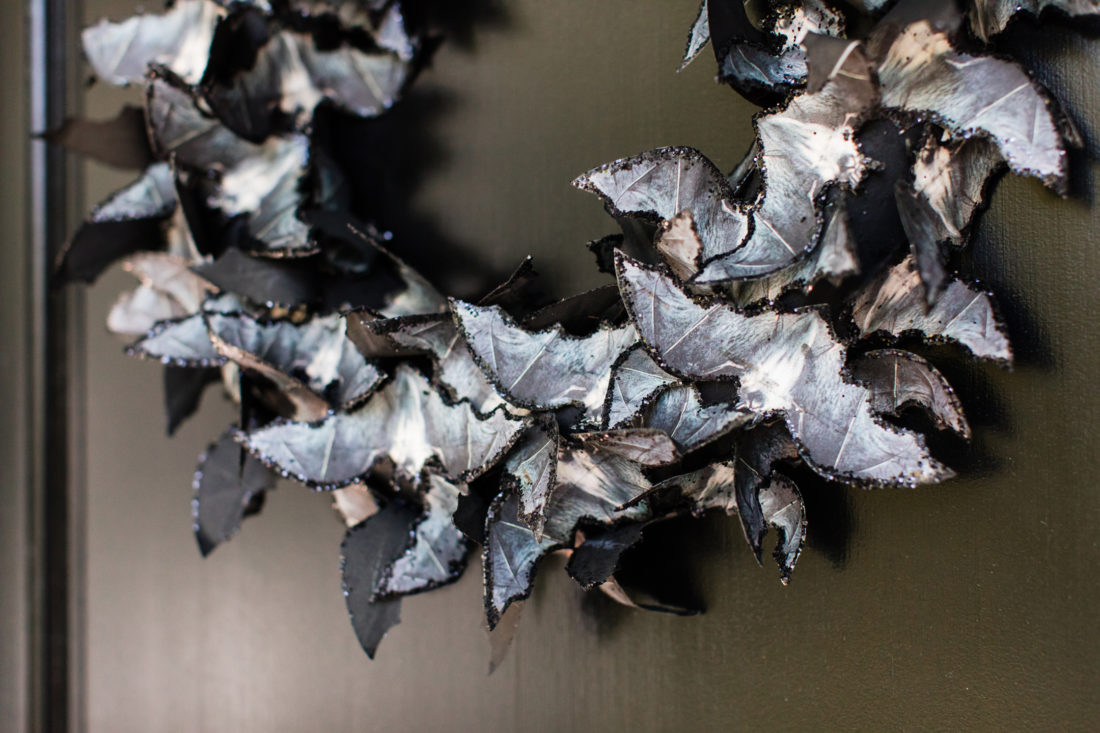 A detail of the sparkly, spooky bat themed wreath on the door of Eva Amurri Martino's Connecticut home