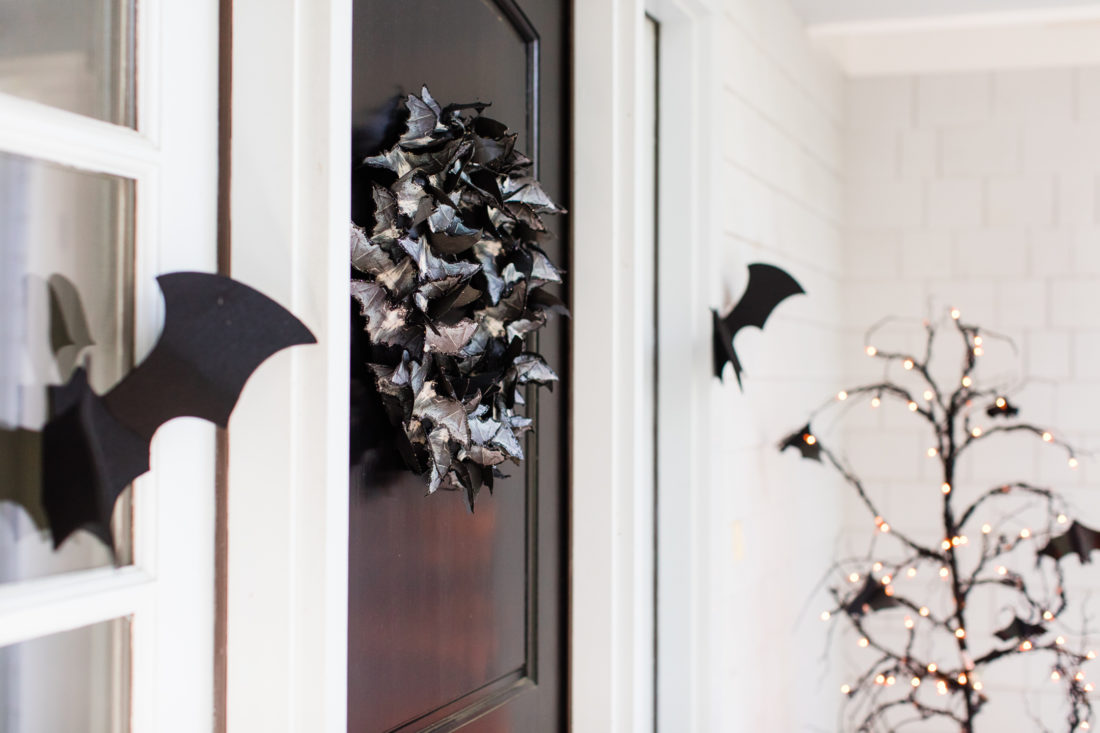 A glittery bat wreath on the black door of Eva Amurri Martino's Connecticut home