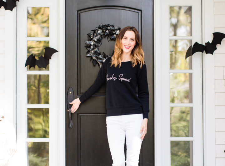 Eva Amurri Martino stands at the entryway to her Connecticut home that is decorated with a spooky bat theme for Halloween
