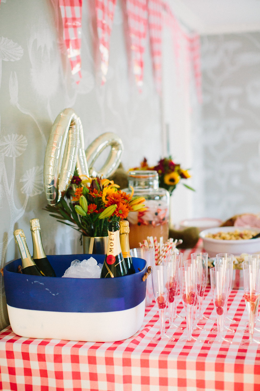 The cocktail setup on the red and white checked buffet for Major Martino's first birthday party with a TEddy bear picnic theme