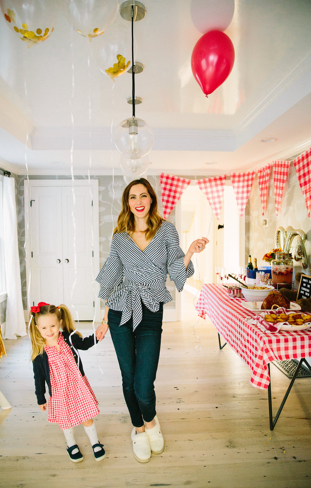 Eva Amurri Martino stands with three year old daughter Marlowe in the room decorated to celebrate Major Martino's first birthday with a teddy bear picnic theme
