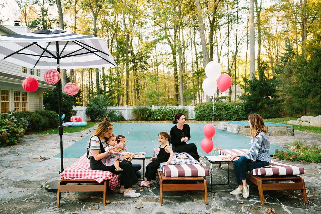 Guests sit outside in Eva Amurri Martino's backyard for Major Martino's first birthday party
