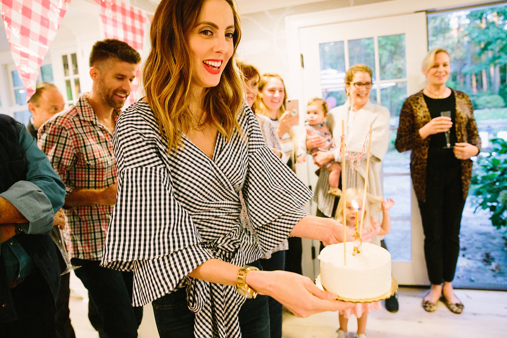 Eva Amurri Martino carries her son's first birthday cake