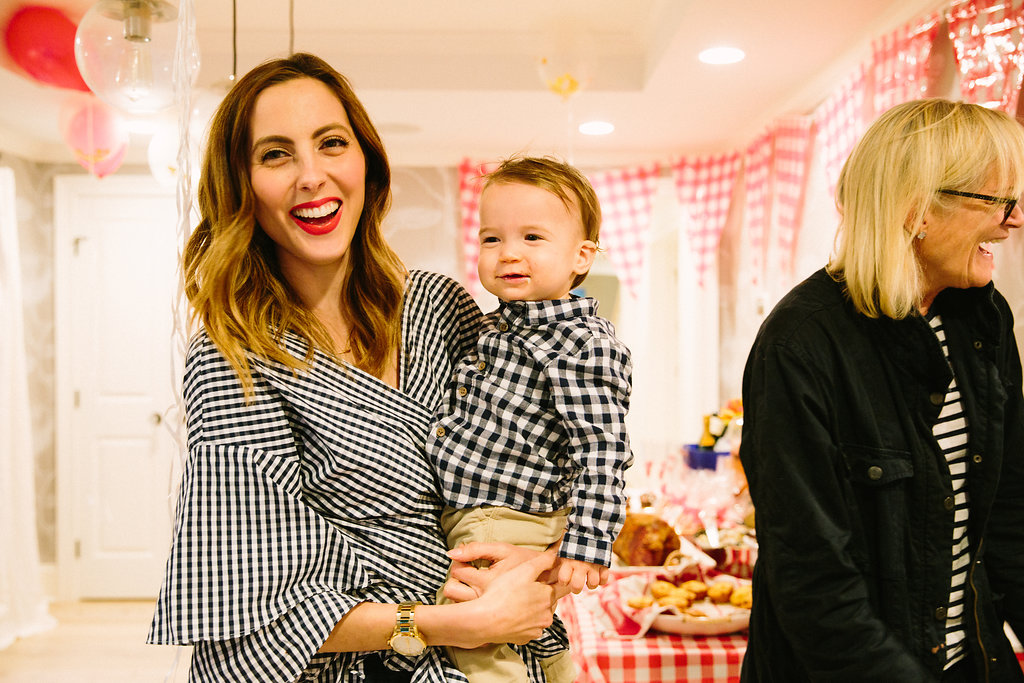 Eva Amurri Martino laughs holding son Major at his first birthday party