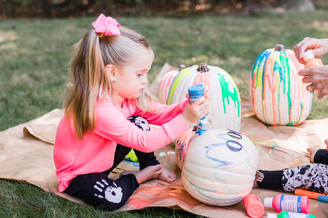 Marlowe Martino creates some DIY technicolor pumpkins in the back yard of her Connecticut home