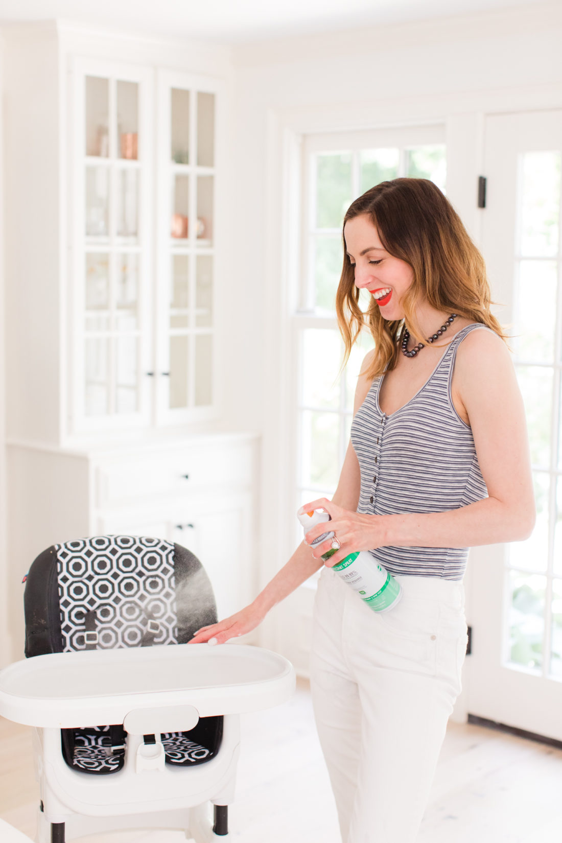 Eva Amurri Martino sprays her son's high chair with seventh generation disinfecting spray