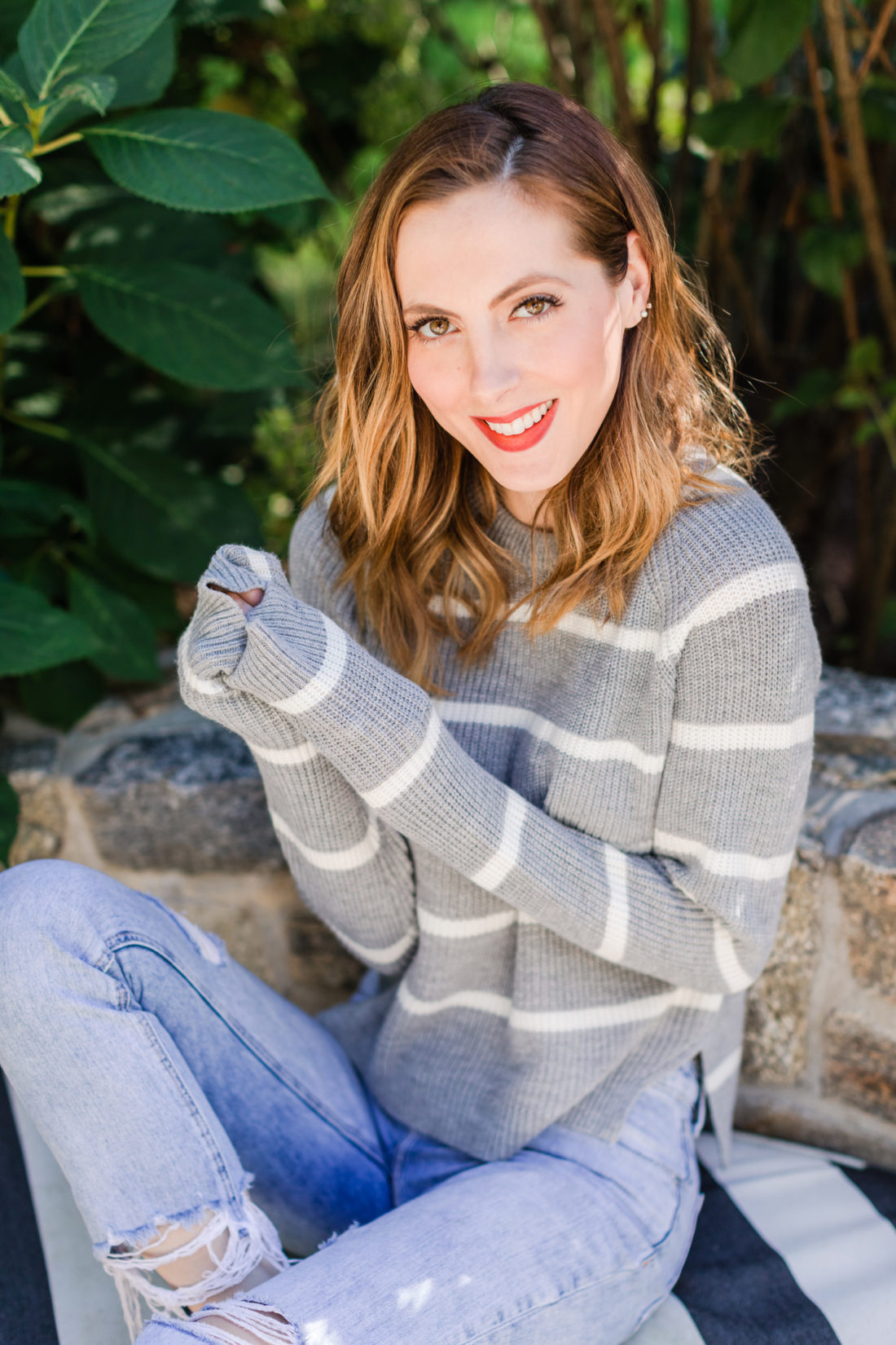 Eva Amurri Martino wears a striped sweater and red heels out by her fire pit in Connecticut