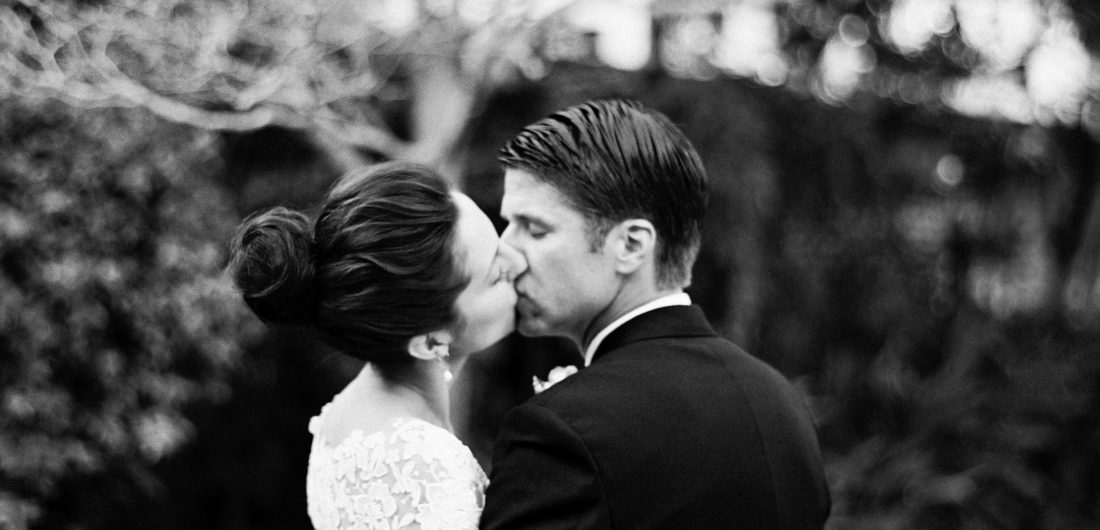 Eva Amurri Martino and Kyle Martino share a kiss in the courtyard on their weddding day in Charleston South Carolina
