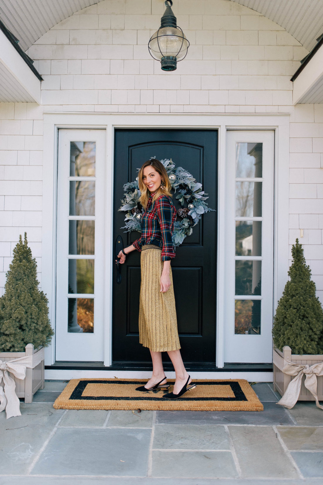 Eva Amurri Martino stands at the doorway of her Connecticut home which is decorated for the holidays
