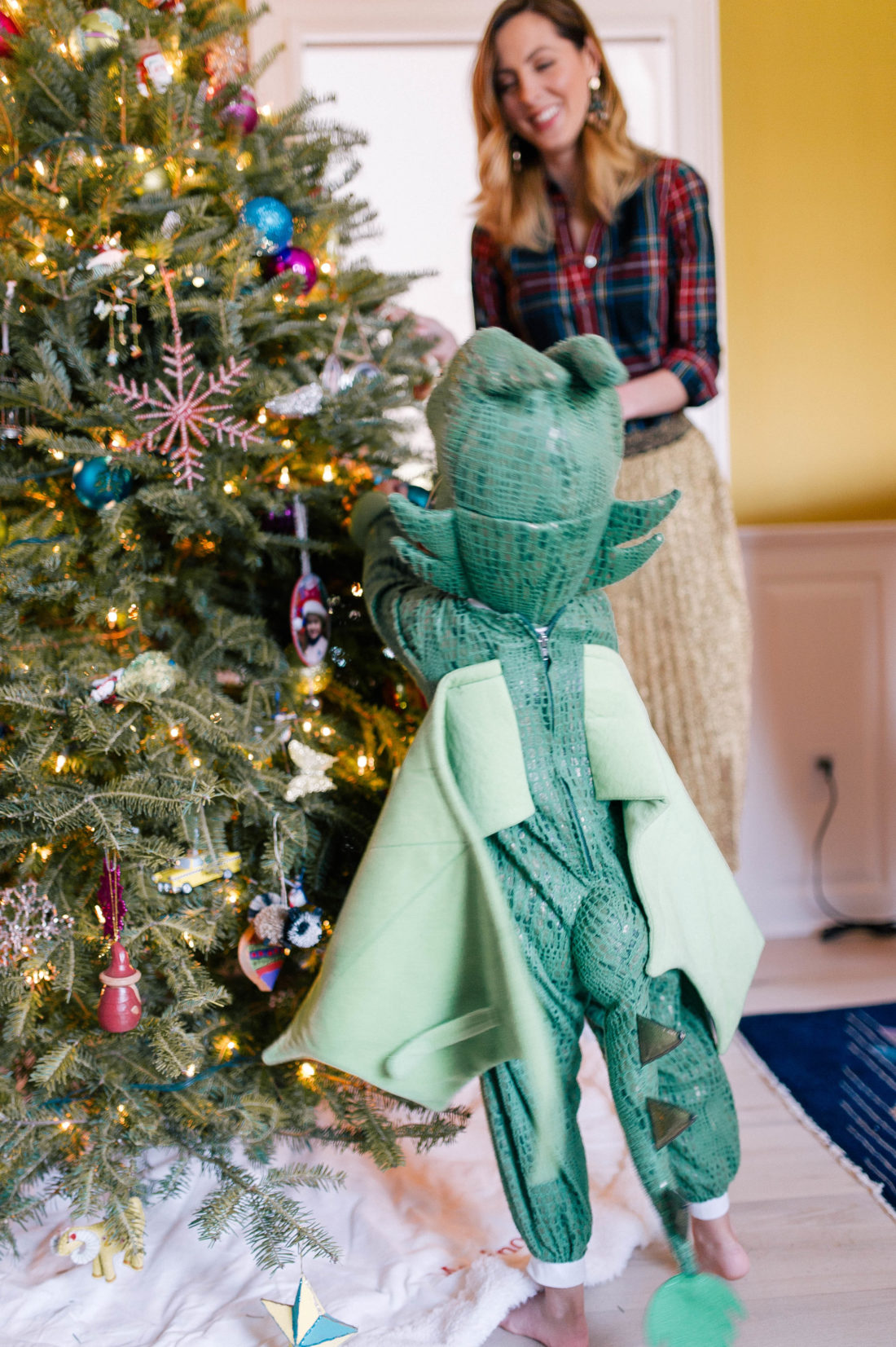Marlowe Martino dresses up in a dragon costume and decorates the christmas tree