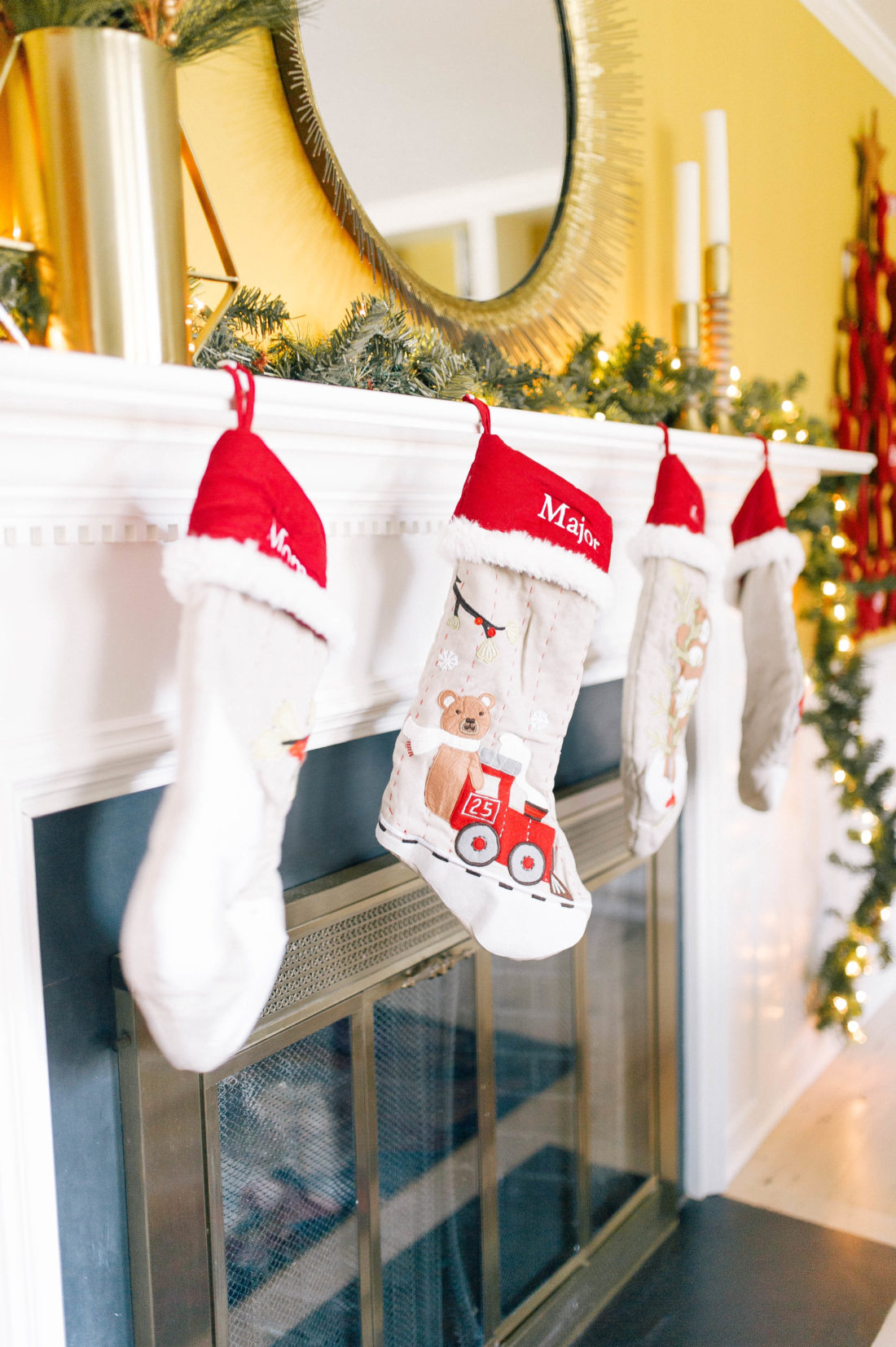 personalized stockings hang off of the mantel in Eva Amurri Martino's Connecticut home