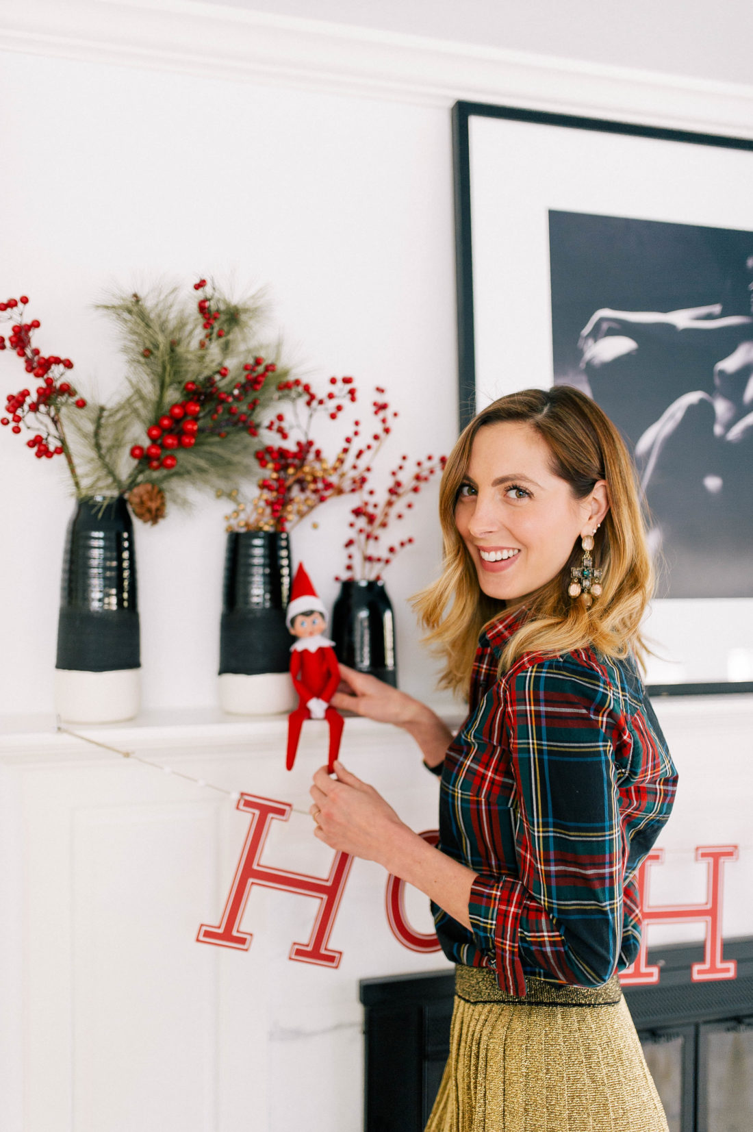 Eva Amurri Martino dresses up her kitchen mantel and places the Elf On The Shelf for the Christmas season