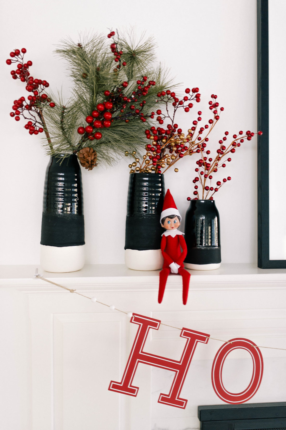 The elf sits on the spruced up shelf as part of the holiday decor in Eva Amurri Martino's Connecticut home