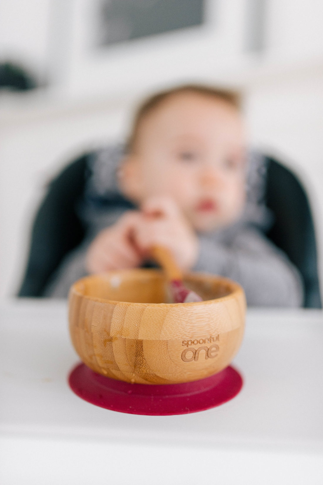 Major Martino eats from a SpoonfulOne bowl in his high chair