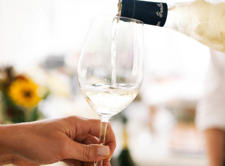 A glass of white wine is poured at Eva Amurri Martino's Connecticut home