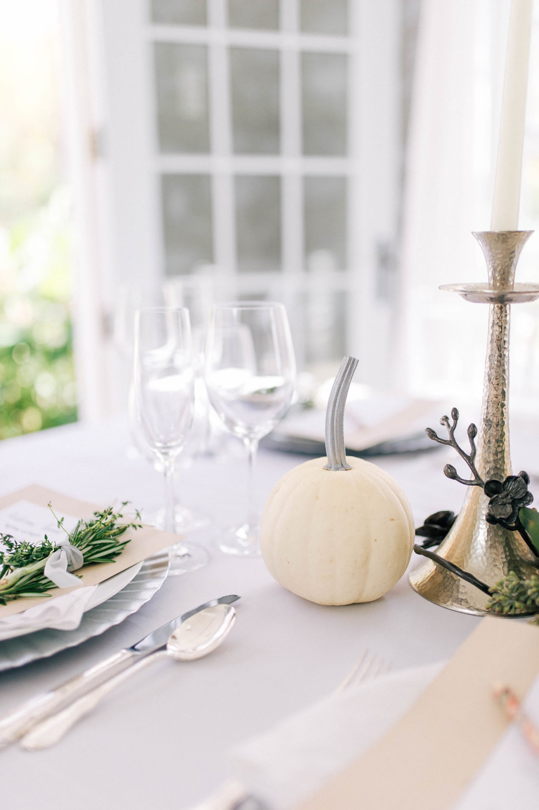 A white pumpkin with a painted silver stem on the Friendsgiving table at Eva Amurri Martino's Connecticut home