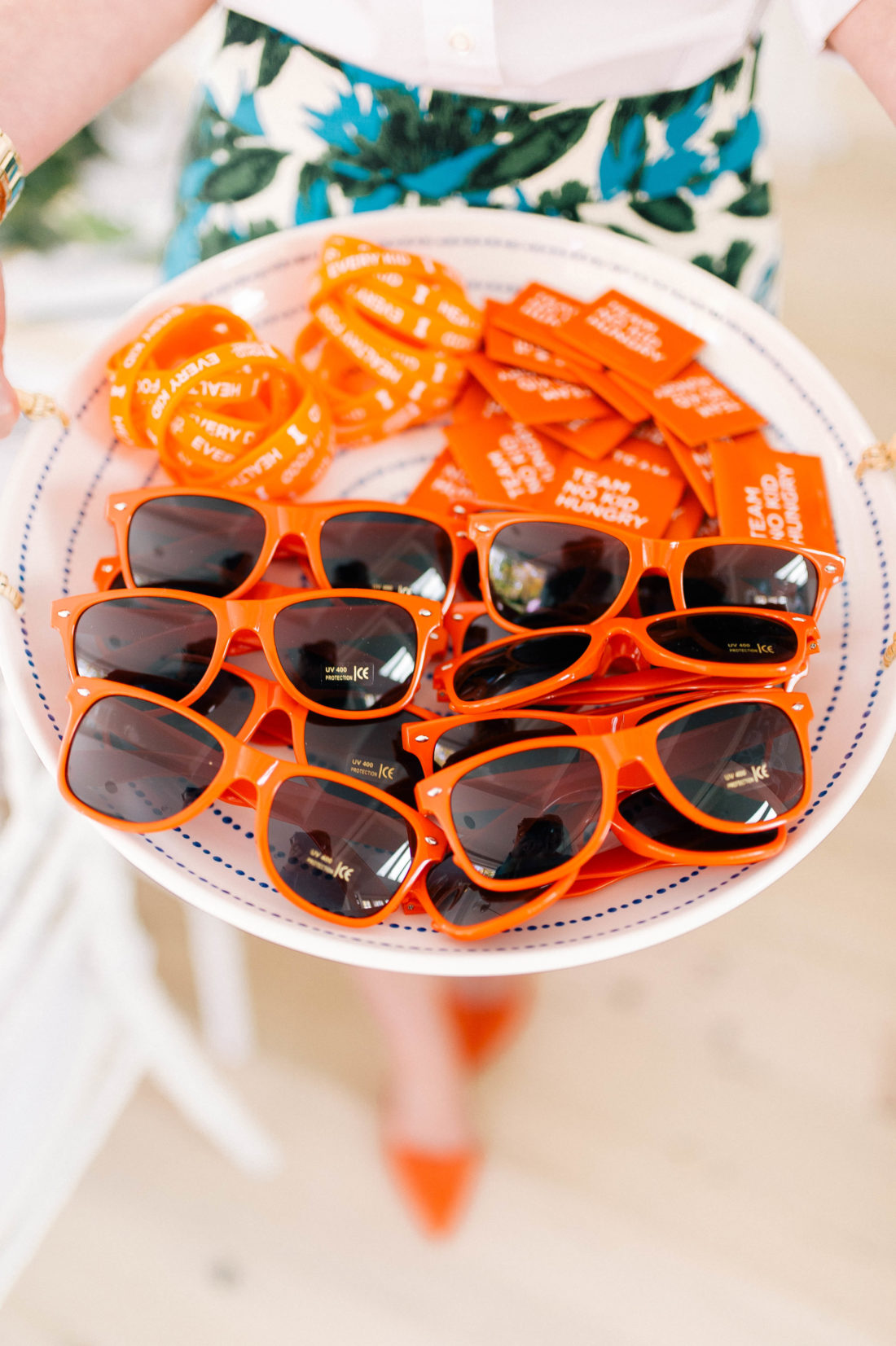 An assortment of orange No Kid Hungry swag at the Friendsgiving at Eva Amurri Martino's Connecticut home