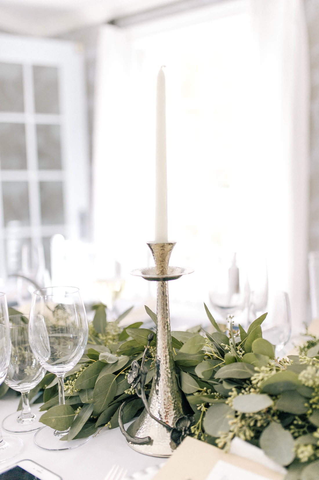 Silver candlesticks amidst the foliage at the Friendsgiving at Eva Amurri Martino's Connecticut home