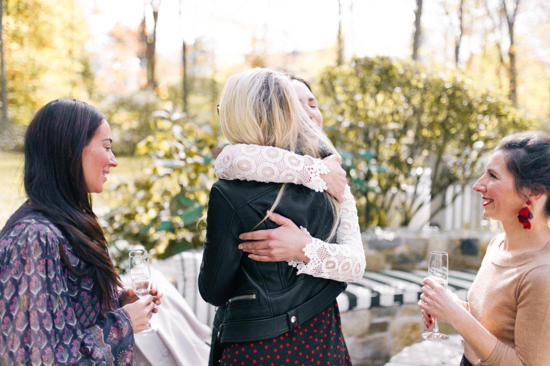 ladies hug at Eva Amurri Martino's Friendsgiving benefitting No Kid Hungry