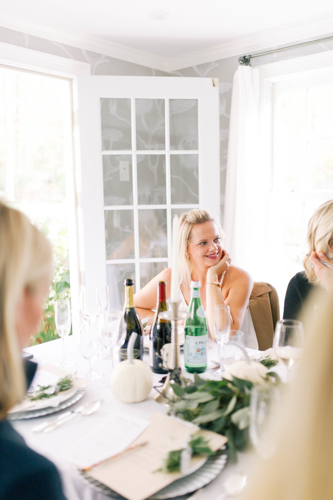 Guests listen as Eva Amurri Martino speaks about her involvement with No Kid Hungry for Friendsgiving